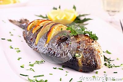 Grilled Sea Bream Fish, Lemon, Arugula On White Plate Stock Photo ...
