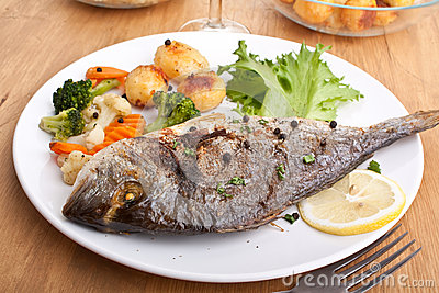 Grilled Sea Bream Fish with Vegetables Stock Photo