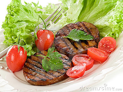 Grilled seitan with tomatoes