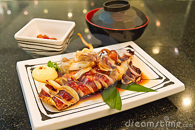 Grilled squid on dish