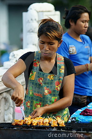 Grilled Squid Vendor at Wat Saket compound. Editorial Photography
