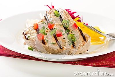 Jalapeno marinated grilled tuna steak with beet and jicama slaw.
