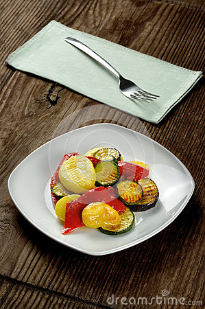 Grilled vegetables on a old wooden table