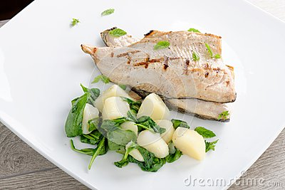 Grilled white fish fillets with potato stock photo image for Grilled white fish recipes