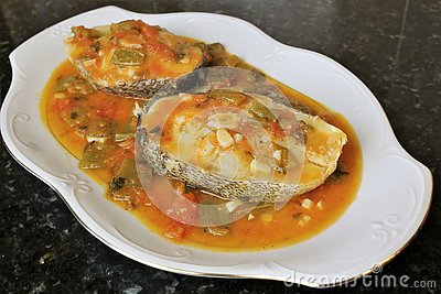 Grilled white fish in sauce with vegetables