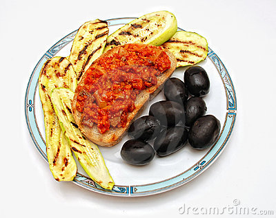 Grilled zucchini, toast bread and olives