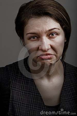 Grimace of unhappy sad disappointed woman
