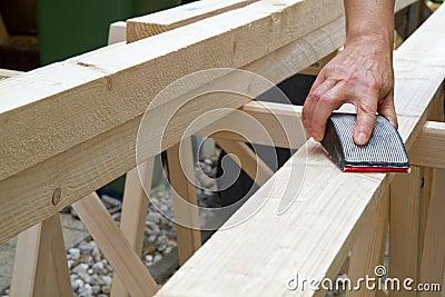 Grinding a wooden beam