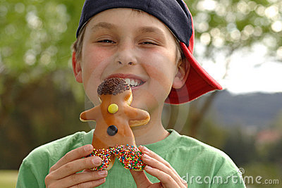 Grinning  boy with a doughnut