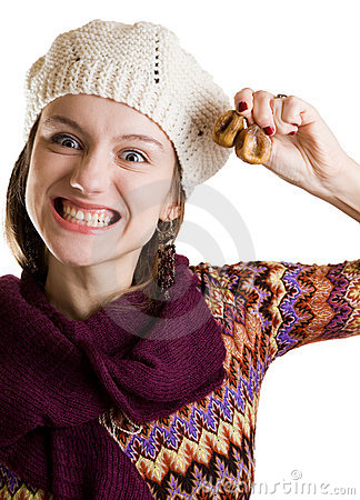 Grinning girl with figs in her hand