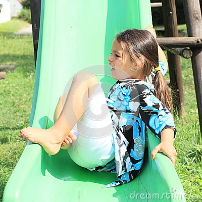 Free Grinning Girl On A Slide Royalty Free Stock Images - 32855149