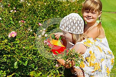 Grls watering flowers