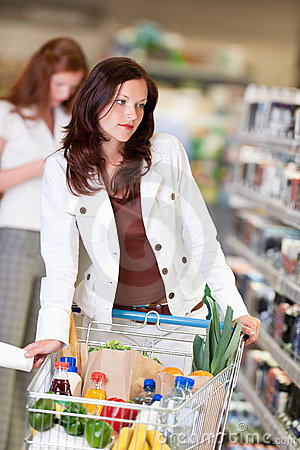 Grocery shopping store - Beautiful brunette woman