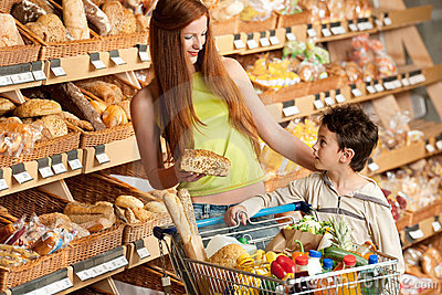 Grocery shopping store - Red hair woman with child