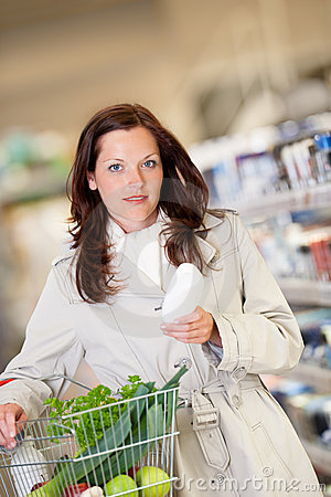 Grocery shopping store  Young woman buying shampoo