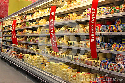 Grocery store cheese shelves Editorial Image