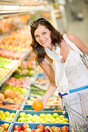 Grocery store - woman shopping choose fruit