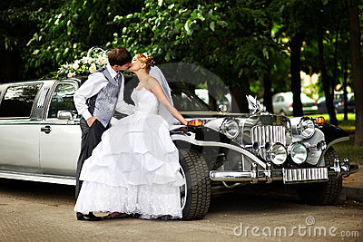 Groom adn bride about retro limousine