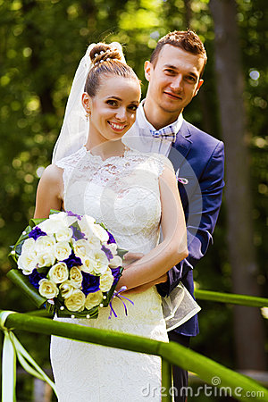 Free Groom And Bride Behind Handrail Royalty Free Stock Photos - 50661298