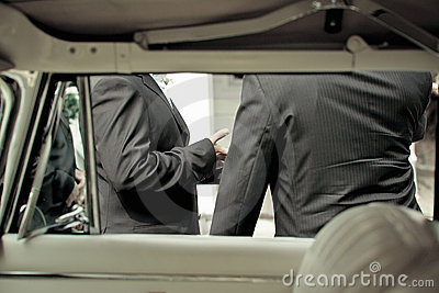 Groom and best man and limousine