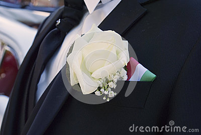 Groom bouquet and his outfit