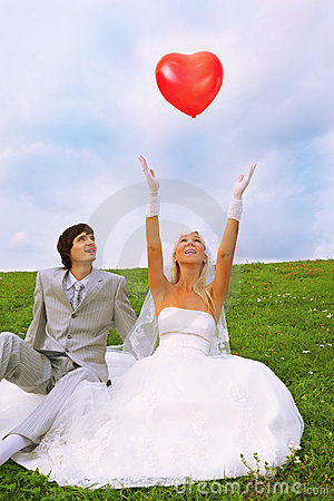Groom and bride; bride throws balloon