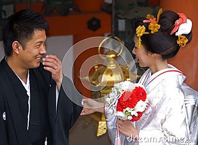 Groom and bride at Kasuga Taisha shrine, Nara, Japan Editorial Stock Photo