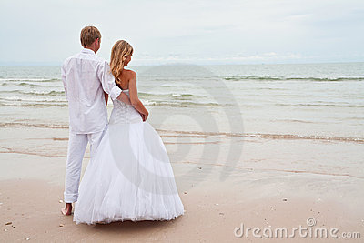Groom and bride ona beach