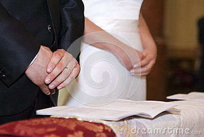 Groom and bride s hands with rings on