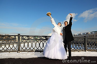Groom and bride shouting and waving their hands