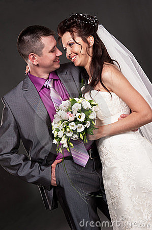 Groom and bride in a studio