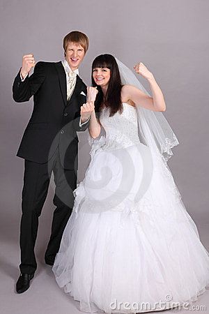 Groom and bride are very happy in studio