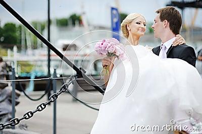 Groom carrying his beautiful bride