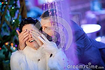 Groom closing eyes to bride