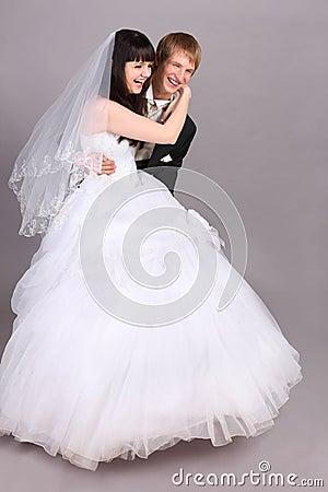 Groom downs on floor bride in studio