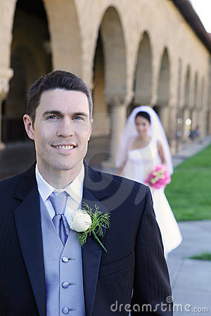 Groom in Front of Bride at Wedding