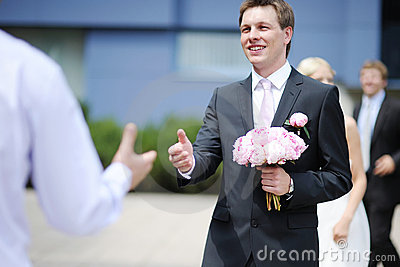 Groom greeting best man