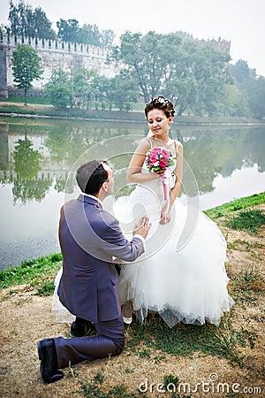Groom on his knees before the bride