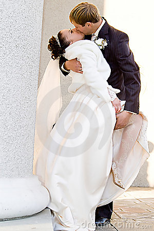 Groom holds bride s leg