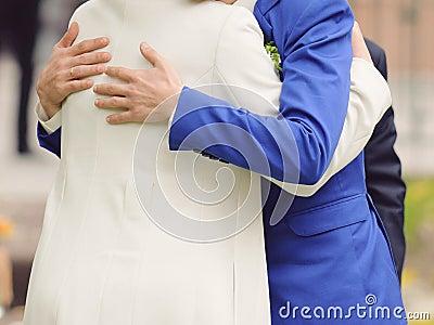 Groom Hugging Mother Stock Photo
