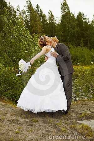 Groom passionately kisses bride