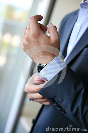Groom s hand with watch
