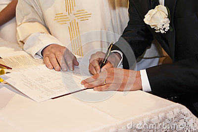 Groom signing