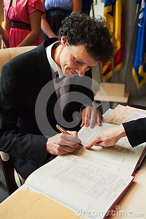 Groom signing papers