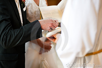 Groom Taking Rings In Wedding Ceremony Stock Image - Image: 12762611