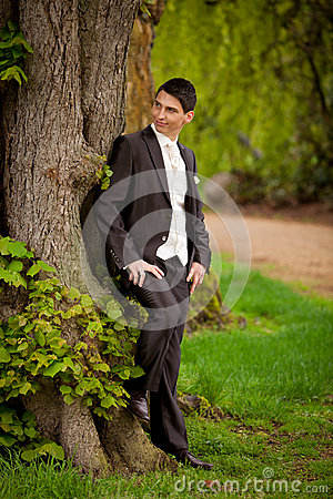 Groom at tree
