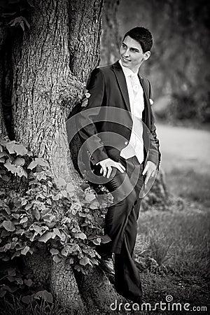 Groom at tree