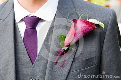 Groom wearing a lily buttonhole