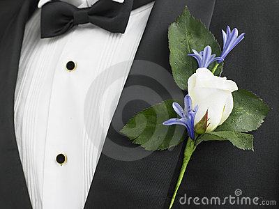 Groom Wearing A Suit With A Rose Corsage