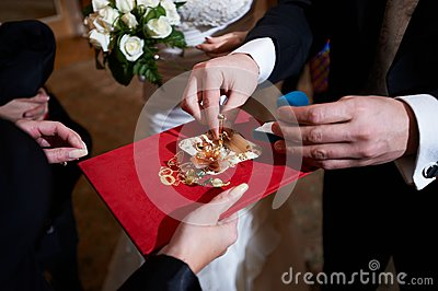 Groom and wedding rings on ceremony of marriage